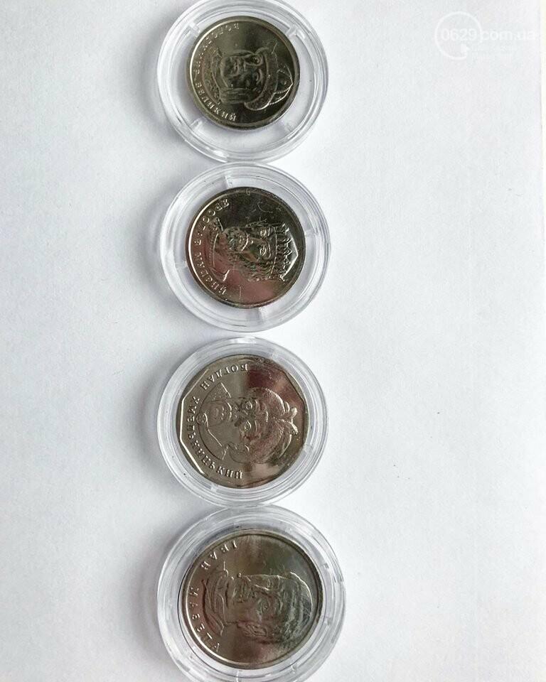 В Украине запустили в обиход новые монеты номиналом 1 и 2 гривны, фото-1