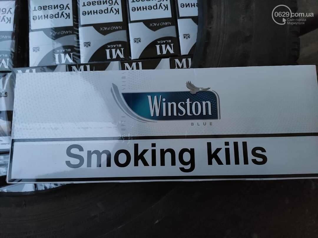 """На КПВВ под Мариуполем мужчина """"накачал"""" колесо 590 пачками сигарет, - ФОТО, фото-3"""